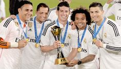 Real Madrid's players celebrate with the trophy after winning the FIFA Club World Cup final football match against San Lorenzo at the Marrakesh stadium in the Moroccan city of Marrakesh on December 20, 2014. Real Madrid defeated San Lorenzo of Argentina 2-0 to win the Club World Cup and secure their fourth trophy of 2014