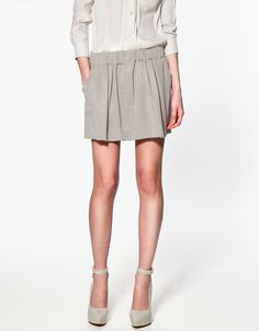 MINI SKIRT WITH ELASTICATED WAIST - Skirts - Woman - ZARA United States. might be a bit short, but the style is nice