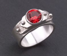 • If you intend on attaching bezels settings, press the tabbed bezels into the formed strips while the clay is still moldable, as well as any other embellishments. • Then, fully dry the embellishment while still draped over the Ring Band.
