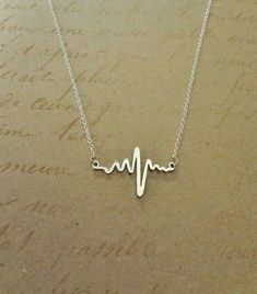 Beautiful Jewelry Electrocardiogram EKG Rhythm Heart Beat Necklace- Simplistically Beautiful and a wonderful statement on many levels. Perfect for anyone in the medical field or who appreciates anatomy! Cute Jewelry, Jewelry Box, Jewelry Accessories, Fashion Accessories, Jewelry Necklaces, Fashion Jewelry, Gold Jewelry, Purple Jewelry, Chanel Jewelry