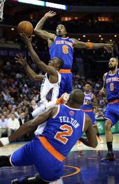 J.R. Smith of the New York Knicks tries to block Kemba Walker of the  Charlotte Bobcats d2aa3fe3e