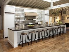 I'm not really into country kitchens, but this one is beautiful. That row of stools has me drooling.