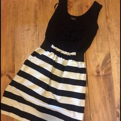 Stripped dress with ruffled detail on bodice. This black and white beauty is ready to be worn again! Great condition only worn once. Has side pockets that blend right in! Candie's Dresses Midi