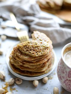 pistachio pancakes with pistachio butter I howsweeteats.com Beignets, Pistachio Butter, Pistachio Recipes, Just Desserts, Dessert Recipes, Savory Crepes, Vegetarian Breakfast Recipes, Food Obsession, Pancakes And Waffles