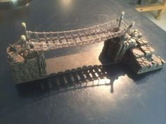 Rope Bridge tutorial by Robster! - The best tutorial for this type of bridge that I have ever seen. Game Terrain, 40k Terrain, Wargaming Terrain, Dungeons And Dragons Miniatures, Warhammer Terrain, Fantasy Miniatures, Warhammer Fantasy, 3d Prints, Fairy Houses