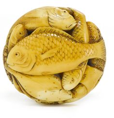 A marine ivory netsuke of a group of fish By Gyokuho, late Edo period (19th century)