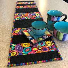 A decorative table runner will add a great pop of color to any area. This piece is machine quilted and hand bound measuring at 38 inches x 10 inches. (Dishes not included)