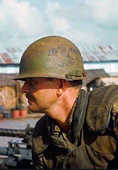 Vietnam War Helmet Graffiti | ca. 1968, Ca Mau, southern Delta, Vietnam --- A side view of an ...