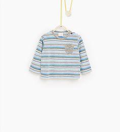 T-shirt à rayures et poche en contraste