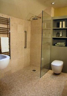 wet room can add glass wall if dont like totally open shower