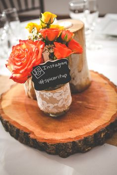 Country Nautical Outdoor Wedding orange and yellow flower arrangements