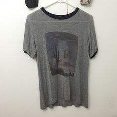 Brandy Melville alien shirt Got it from Brandy store and I don't wear it anymore Brandy Melville Tops Tees - Short Sleeve