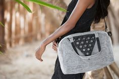 Eco-friendly hand-crocheted shoulder bag made from black plastic bags cut into strips then hand-crocheted mixed with multipurpose netting. 100% Italian design, 100% Made in Cambodia