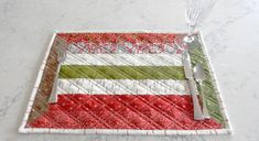 The Holidays are a while off but I thought today would be a great time to get ahead of the Holiday Season rush and make some new placemats for my dining room table using my new BERNINA 790 PLUS. These Placemats are quick and easy to make and it means I've got one more holiday item checked off my to do list! Keep reading to find out how I made these. #sewing #placemat #quilting #patchwork #beginner #free #pattern #tutorial