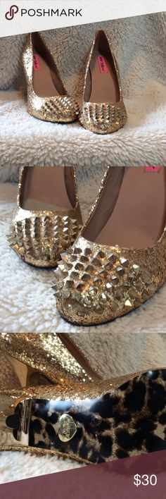 Betsey Johnson Gold Glittery Heels With Spikes Betsey Johnson Gold Glittery Heels With Spikes. Heel height is 4 inches. Never worn. Cheetah print with gold Betsey heart on soles. Great for Homecoming/Prom Betsey Johnson Shoes Heels