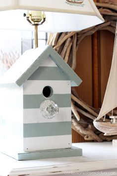 I JUST LOVE THE WAY THE BIRD HOUSE IS PAINTED!- Coastal Inspired Bird House Lamps from Confessions of a Serial Do-it-Yourselfer