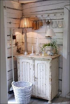 Love the rustic styling around this charming cupboard.