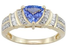 .75ct Trillion Tanzanite With .20ctw Baguette And Round Diamond 10k Yellow Gold Ring... Size 6 please!  (This reminds me of the ring I passed up in Jamaica. Time to get it finally!