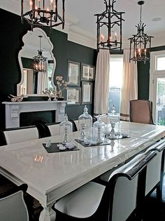 I love everything about the room...white black....table setting is awesome....huge mirror....lights awesome...I want this please.
