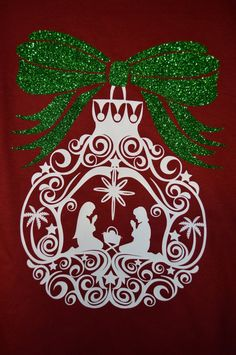 Show your Christmas spirit with our Long Sleeve Monogrammed Nativity Shirt. The shirt features your monogram on the front in a vine interlocking pattern and on the back a large glitter bow highlights an ornament showing the nativity scene. This shirt is perfect to wear to casual church gatherings, to Christmas parades, or just to show your Christmas spirit as you Christmas shop for your loved ones.  In notes to seller please include the following information: monogram initials in first…