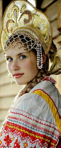 Russian Girl w/ Kokoshnik: A traditional piece of female headware dating back to the 17th century, but similar to other headware dating back to the 10th century.  It is most closely tied to matrimony;  married women were forbidden to show their hair in public,  w/ the Kokoshnik it could be plaited and tucked under, out of view.  Banned by Peter the great for the social elite, it was brought back by Catherine the Great, & has remained a patriotic symbol since, & is often seen at weddings.