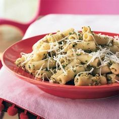 Rigatoni with Green Olive-Almond Pesto and Asiago Cheese. This made-in-the-processor pasta sauce combines olives and almonds for a twist on traditional pesto. It's also nice as a base on pizza.