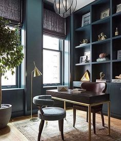 Dark and moody office beauty, from @consortdesign. #officedecor #officestyle #bookshelf #bookshelves #darkwalls #styleinspiration #interiordesign //  via @ashleytstark & @stonetextile