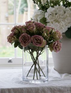 Beautiful faux flowers to create a fabulous centrepiece for your Easter table. From these gorgeous faux roses to faux white hydrangeas, we've got an array of wonderful blooms with which to style your home. #flowershop