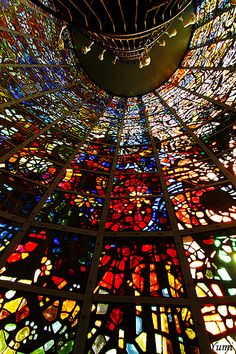 The structure of building one's way to the heavens in pieces of light. ---tower of stained glass