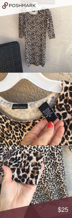 Moda Leopard body con dress Moda Leopard body con dress worn once washed twice Moda International Dresses Mini