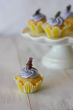 Lemon curd-filled cupcakes with honey lavender frosting. From Yummy Mummy