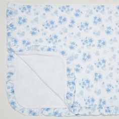 A lovely blanket for your baby girl from Kissy Kissy Heart Blossom collection. Made from Peruvian pima cotton, this blanket has cute blue hearts and blossoms print. It's perfect for wrapping baby up at home, use in car seat, baby stroller or nursery crib. Complete baby's look with other items in the Heart Blossom range.