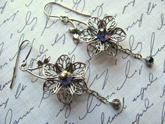 """Filigree Flower Earrings - Silver Pewter Flowers Swarovski Crystals Pewter Chain  """"Lotus Blossom"""" earrings hang from 20 gauge antiqued silver plated earwires and measure approximately 2 1/2"""" from the top of the earwire.  #thecraftstar #happyeverything #earrings #gifts"""