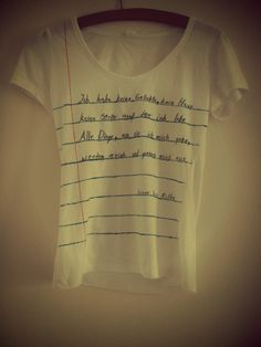 This is such a cool DIY t-shirt design! All you really need is a white T (or whatever colour really); fabric markers; and a long, straight edge to draw the lines.   (Sidenote: I have absolutely no idea what the shirt says. I do not speak German.)