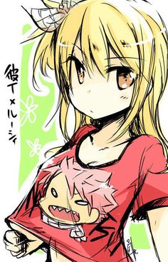 Lucy wearing a t-shirt with Natsu's face on it
