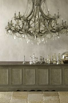 the most spectacular chandelier, amazing sideboard, tons of silver candlesticks
