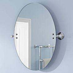 Photo On The Milano Bianco oval mirror will add traditional elegance to any bathroom