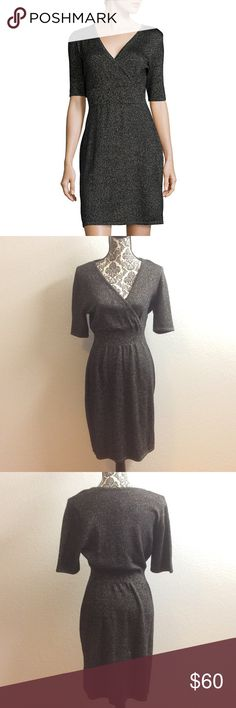 🆕Liz Claiborne 3/4 sleeve sweater dress Sleeve Length: 3/4 Sleeve Dress Length: Mid Length Fabric Content: 40% Polyester, 20% Nylon, 40% Viscose Fabric Description: Knit Country of Origin: Imported size Large. Color is black with silver Liz Claiborne Dresses Midi