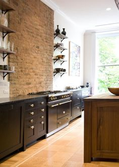 A remodeled brownstone in Brooklyn… Kitchen, open shelving, black cabinets, exposed brick, Lacanche Range Kitchen Interior, Kitchen Decor, Kitchen Ideas, Kitchen Layout, Diy Kitchen, Townhouse Interior, Casa Cook, Industrial Style Kitchen, Brooklyn Brownstone