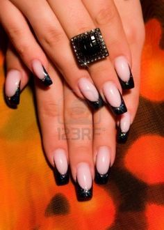 French manicure with black tips and a illusion of a rounded shape