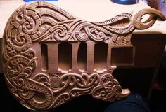 Carved guitar body.