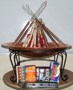 Fire pit silent auction basket idea ~ Great way to highlight a Fire pit - Basket - add Smore supplies and fire starters- Link has additional basket ideas from their auction Fundraiser Baskets, Raffle Baskets, Gift Baskets, Chinese Auction, Silent Auction Baskets, Theme Baskets, Auction Projects, Auction Items, Homemade Gifts