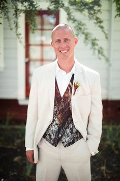 cream with camouflage vest for groom look http://www.weddingchicks.com/2014/02/08/cowboy-western-chic-wedding-at-retzlaff-vineyards-in-livermore-by-heather-elizabeth-photography/