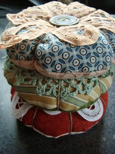 Doily Pin Cushion Tutorial - These are a nice take on the ol tomato cushion.