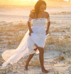 Beautiful beach scene with a gorgeous wedding dress with lace!:)