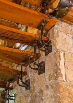 Twisted Iron under stairs. Magnum Opus: A Rustic Log Home in New York – LogHome.com
