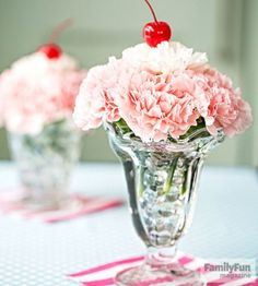 "Making these carnation ""sundaes"" is a great pre-party activity for the kids. Have them place glass marbles in each dish, leaving an inch or so of space at the top, then add water. Insert the carnations and top with a cherry. Originally published in the May 2015 issue of FamilyFun magazine."