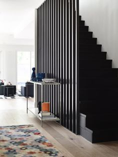 "A modern staircase feature via Mim Design. See how to ""Step Up Your Staircase Game with This Modern Design Trend"" Stair Railing Design, Home Stairs Design, Interior Stairs, Modern House Design, Home Interior Design, Staircase Design Modern, Interior Modern, Railings, Interior Decorating"