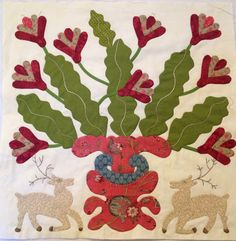 Adaptation of the Rachel Meyer quilt by Happy Appliquer. The plant is speculated to be a Christmas Cactus.