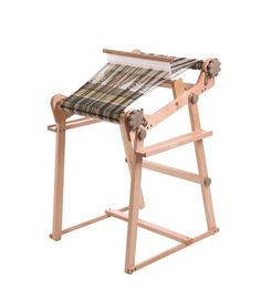 A strong and sturdy loom stand is available for the following three Rigid Heddle Loom, 60cm/24, Easy to assemble and attach, with two handy shelves. Convenient loom angle and foot rest for comfortable weaving. Made from solid Silver Beech hardwood to match your loom.